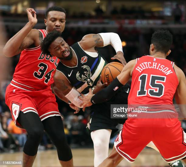 Milwaukee Bucks guard Wesley Matthews is defended by Chicago Bulls center Wendell Carter Jr and Chandler Hutchison in the first half Monday Nov 18...