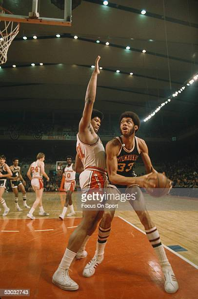 Milwaukee Bucks' Kareem Abdul Jabbar looks to shoot as he is guarded by Wes Unseld of the Washington Bullets at Capital Center circa the 1970's in...
