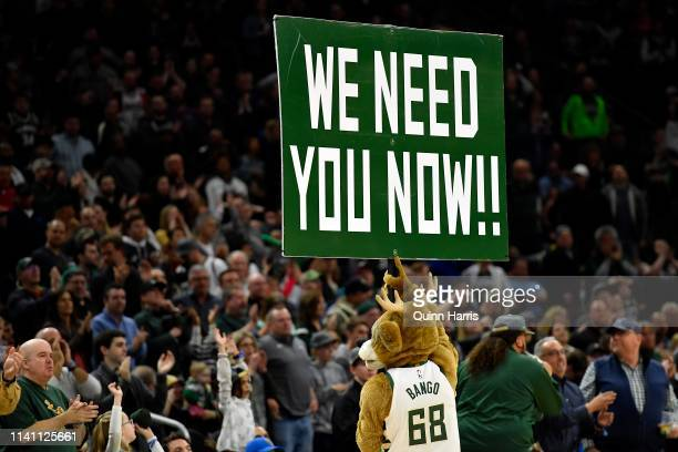 Milwaukee Bucks mascot holds up a sign in the second half of the game against the Brooklyn Nets at Fiserv Forum on April 06 2019 in Milwaukee...