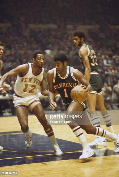 Milwaukee Bucks' Oscar Robertson dribbles against New York Knicks' Dick Barnett during a game at Madison Square Garden in New York New York