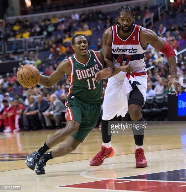 Milwaukee Bucks point guard Brandon Knight drives to the basket against Washington Wizards power forward Nene Hilario during the first half of their...