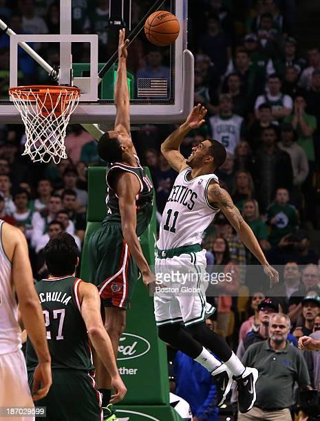 Milwaukee Bucks power forward John Henson blocks a shot attempt by Boston Celtics shooting guard Courtney Lee late in the fourth quarter. The Boston...