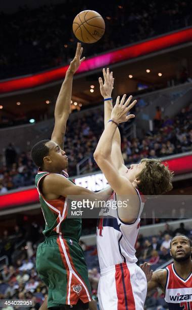 Milwaukee Bucks power forward John Henson shoots over Washington Wizards power forward Jan Vesely during the first half of their game played at the...