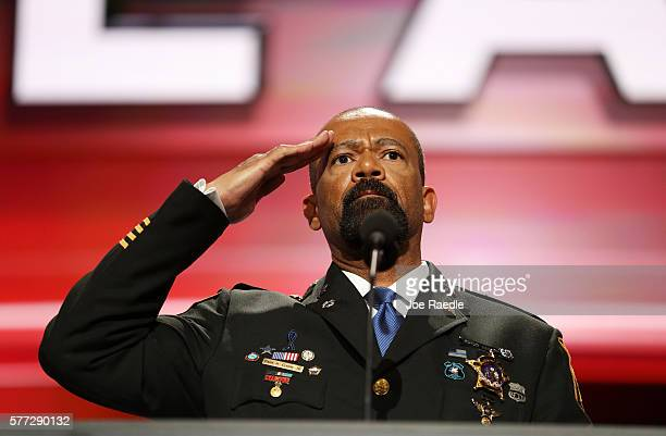 Milwaukee County Sheriff David Clarke salutes the crowd prior to delivering a speech on the first day of the Republican National Convention on July...