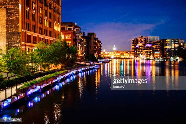 milwaukee downtown riverbank by night - milwaukee stock pictures, royalty-free photos & images