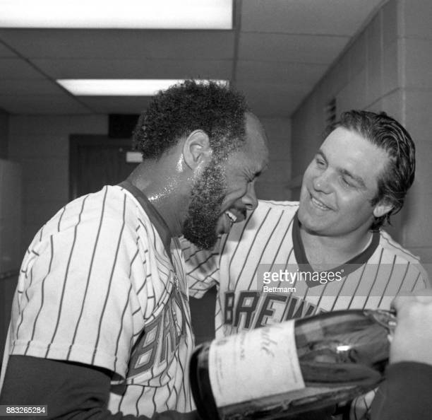 Milwaukee First baseman Cecil Cooper is congratulated in the clubhouse by outfielder Mark Brouhard after the Milwaukee Brewers defeated the...