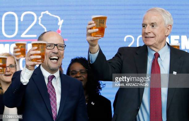 Milwaukee Mayor Tom Barrett and Chair of the Democratic National Committee Tom Perez toast with a beer during a press conference at the Fiserv Forum...