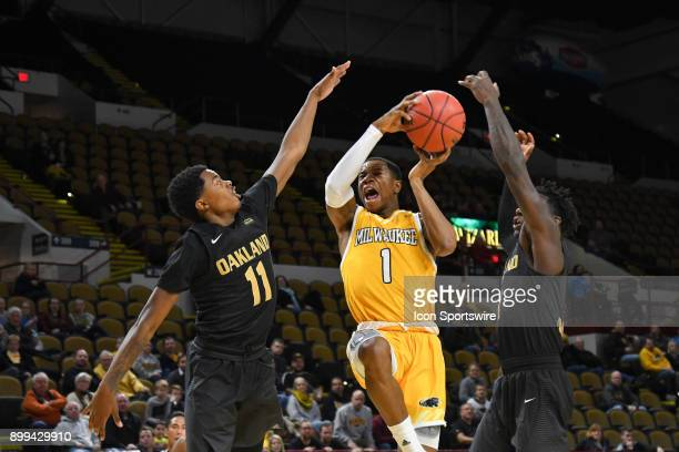 Milwaukee Panthers G Jeremiah Bell goes up strong with Oakland Grizzlies G Brailen Neely and Oakland Grizzlies G Kendrick Nunn defending in the...