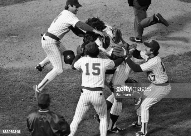 Milwaukee players leap on each other in jubilation after they beat California Angles to win the American League title Catcher Ted Simmons leaps on...