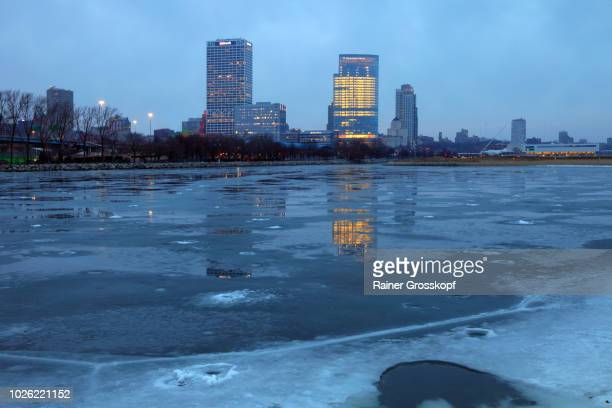 Milwaukee Skyline reflected on frozen lake at dawn