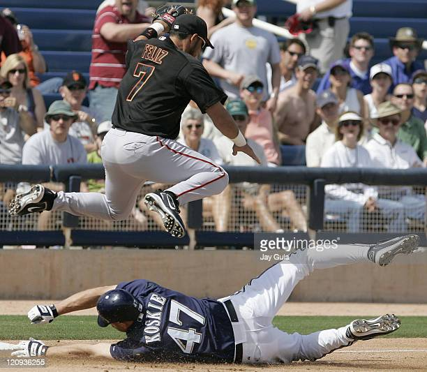 Milwaukee's Corey Koskie slides in to 3rd base safely ahead of the tag from SF 3B Pedro Feliz in Cactus League action at Maryvale March 23 2006