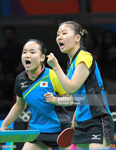 Mima Ito and Ai Fukuhara of Japan celebrate a point against Shan Xiaona and Petrissa Solja of Germany in the Women's Team Semifinal between Japan and...