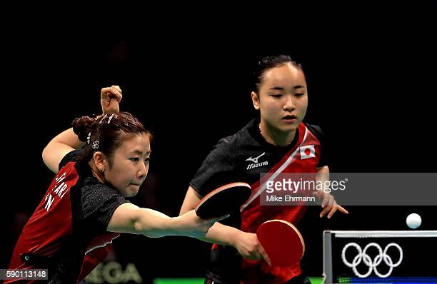 Mima Ito and Ai Fukuhara of Japan play a doubles match against Yihan Zhou and Mengyu Yu of Singapore during the Womens Team Bronze Medal match on Day...
