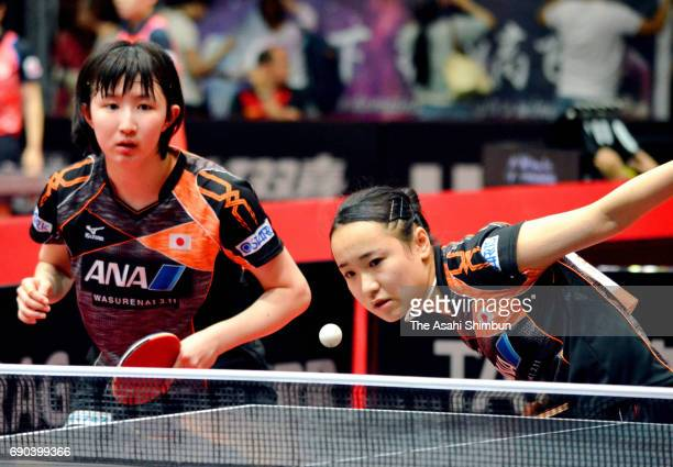 Mima Ito and Hina Hayata of Japan compete in the Women's Doubles first round match against Rahel Aschwanden of Switzerland and Caroline Kumahara of...