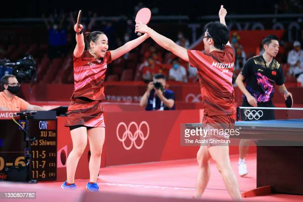 Mima Ito and Jun Mizutani of Team Japan celebrate winning the gold medal after beating Liu Shiwen and Xu Xin of Team China in the Mixed Doubles final...