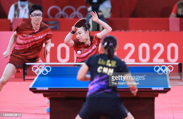 Mima Ito and Jun Mizutani of Team Japan compete against Liu Shiwen and Xu Xin of Team China in the Mixed Doubles final on day three of the Tokyo 2020...