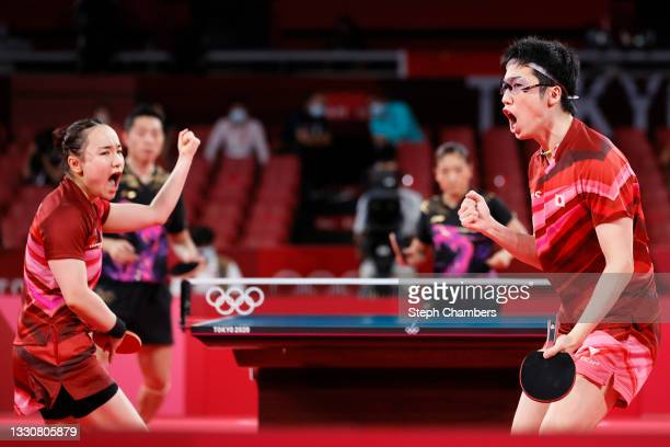 Mima Ito and Jun Mizutani of Team Japan react during their Mixed Doubles Gold Medal match on day three of the Tokyo 2020 Olympic Games at Tokyo...