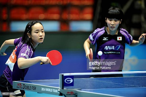 Mima Ito and Miu Hirano of Japan in action during Women's double quarter final of the 2014 ITTF World Tour Grand Finals at Huamark Indoor Stadium on...