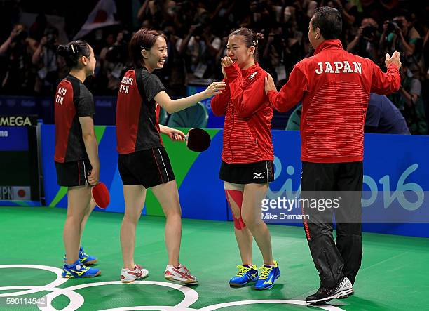 Mima Ito Kasumi Ishikawa and Ai Fukuhara of Japan celebrate winning the Womens Team Bronze Medal match against Singapore on Day 11 of the Rio 2016...
