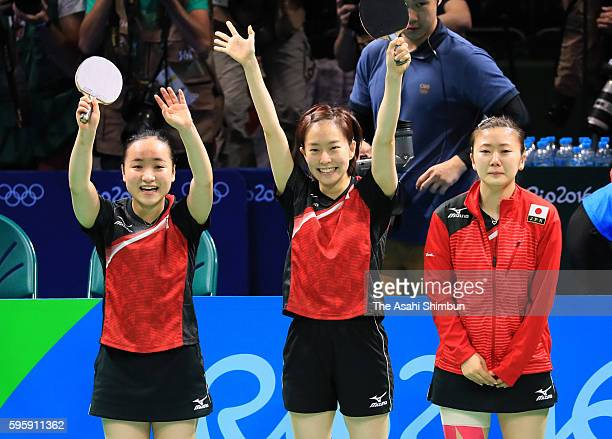 Mima Ito Kasumi Ishikawa and Ai Fukuhara of Japan celebrate winning the bronze medals after beating Singapore in the Table Tennis Women's Team bronze...