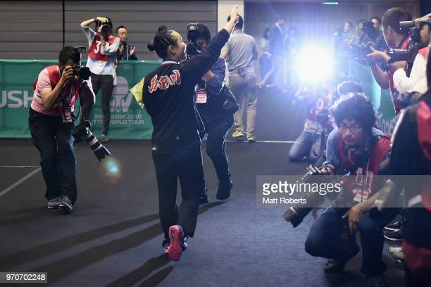 Mima Ito of Japan acknowledges the crowd after winning the women's singles final against Manyu Wang of China on day three of the ITTF World Tour LION...
