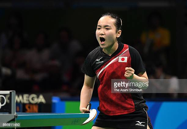 Mima Ito of Japan celebrates a point against Feng Tianwei of Singapore in the Table Tennis Women's Team bronze medal match on Day 11 of the Rio 2016...