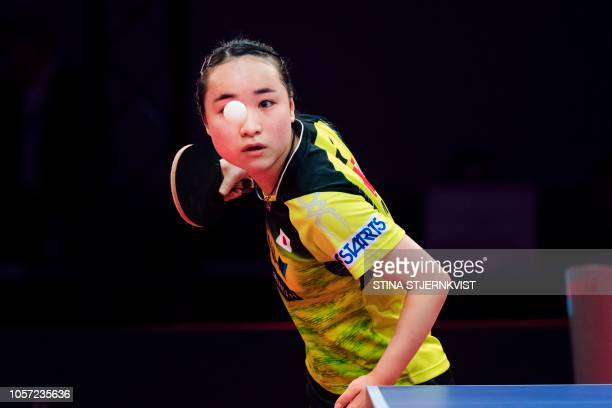 TOPSHOT Mima Ito of Japan eyes the ball as she serves in her match against Zhu Yuling of China during the women's single final table tennis match at...