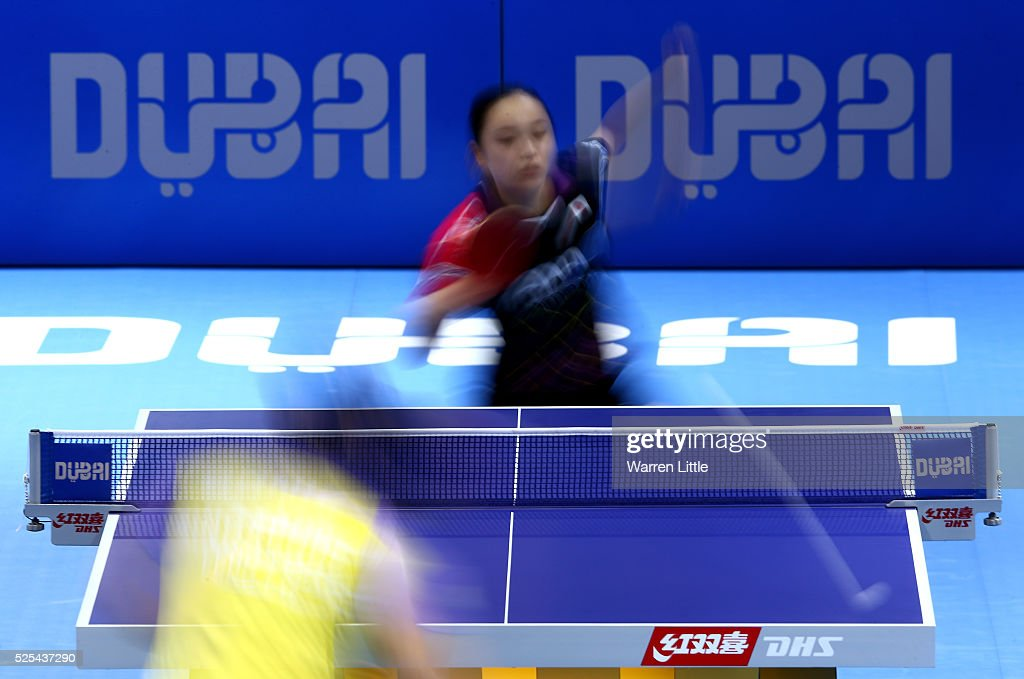 Mima Ito of Japan in action against Feng Tianwei of Singapore during day one of the Nakheel Table Tennis Asian Cup 2016 at Dubai World Trade Centre on April 28, 2016 in Dubai, United Arab Emirates.