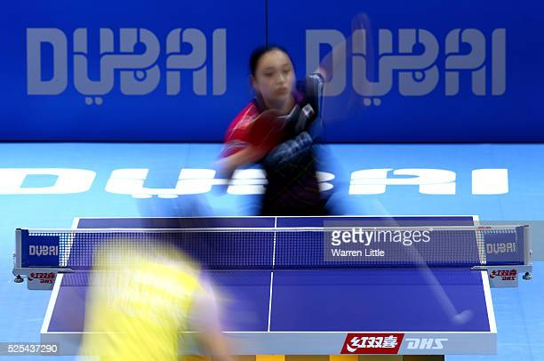 Mima Ito of Japan in action against Feng Tianwei of Singapore during day one of the Nakheel Table Tennis Asian Cup 2016 at Dubai World Trade Centre...