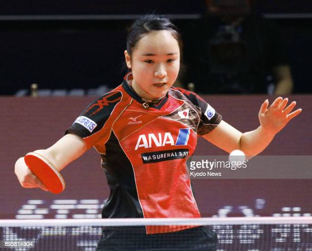 Mima Ito of Japan plays a shot during her quarterfinal match against China's Chen Xingtong at the seasonending ITTF World Tour Grand Finals in Astana...