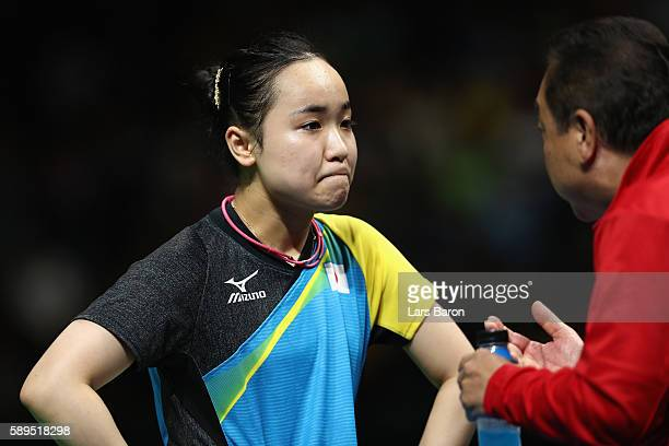 Mima Ito of Japan reacts after being defeated by Petrissa Solja of Germany in the Women's Team Semifinal 2 on Day 9 of the Rio 2016 Olympic Games at...