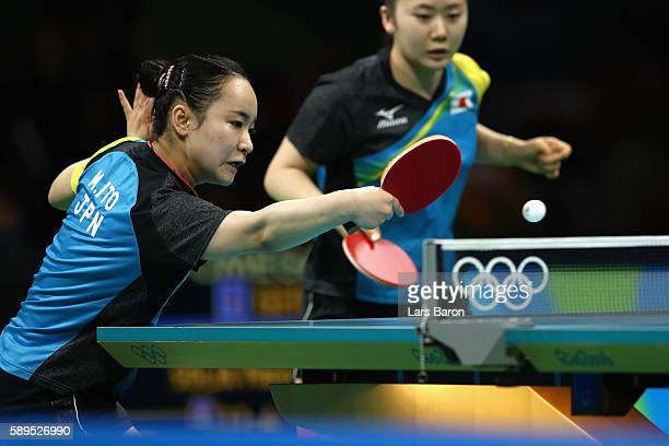 Mima Ito of Japan returns a shot during the Women's Team Semifinal 2 against Xiaona Shan and Petrissa Solja of Germany on Day 9 of the Rio 2016...