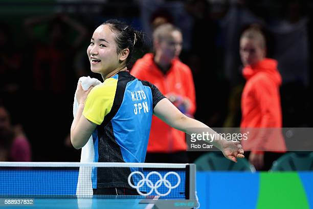 Mima Ito of Japan smiles after winning her match against Poland during the Women's Team Round 1 on Day 7 of the Rio 2016 Olympic Games at Riocentro...