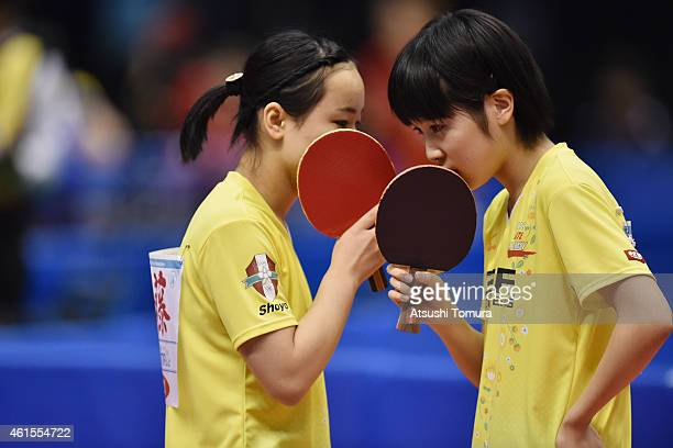 Mima Ito talks to her teammate Miu Hirano of Japan in the Women's Doubles during the day four of All Japan Table Tennis Championships 2015 at Tokyo...