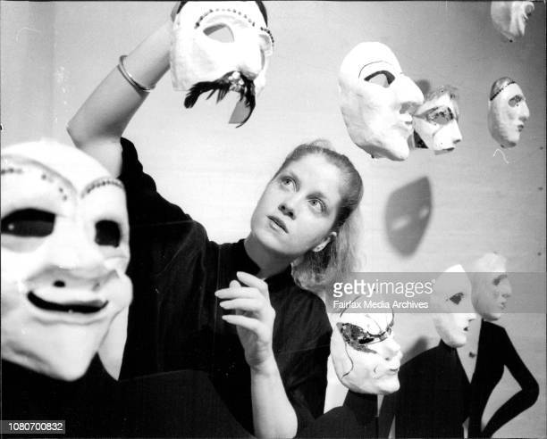 Mime Artist Bridget Murphy of Potts Point adjusts some of cabaret masks made by her for an exhibition of masks and mime performance at No 1 Central...