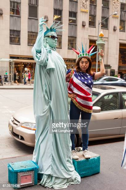 Mime artist dressed as Statue of Liberty, and tourist, Manhattan, New York City, New York, USA