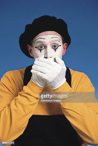 mime covering mouth - mime stock photos and pictures