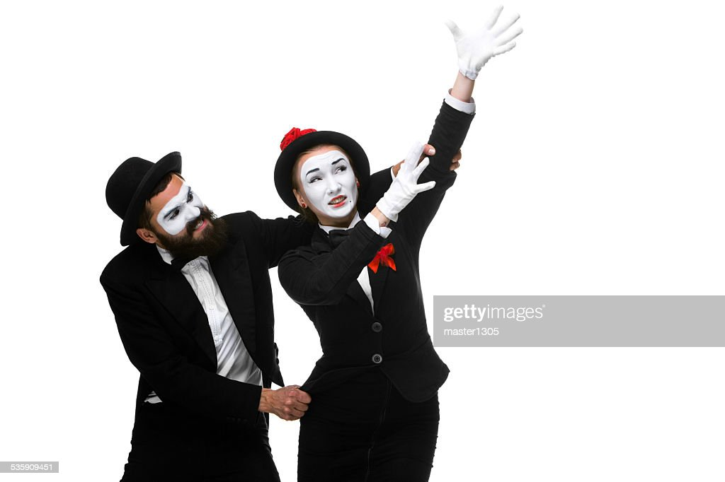mime holding another one up and running : Stock Photo