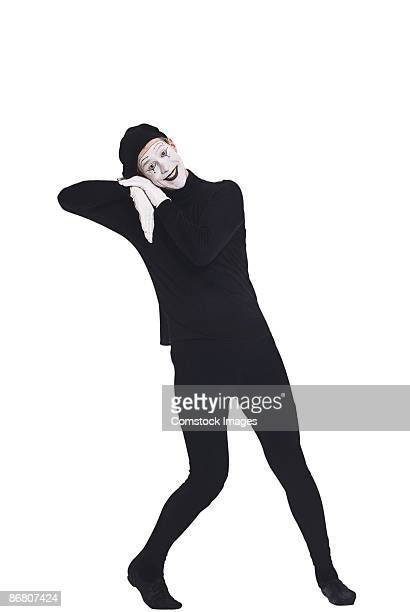 Mime leaning and smiling