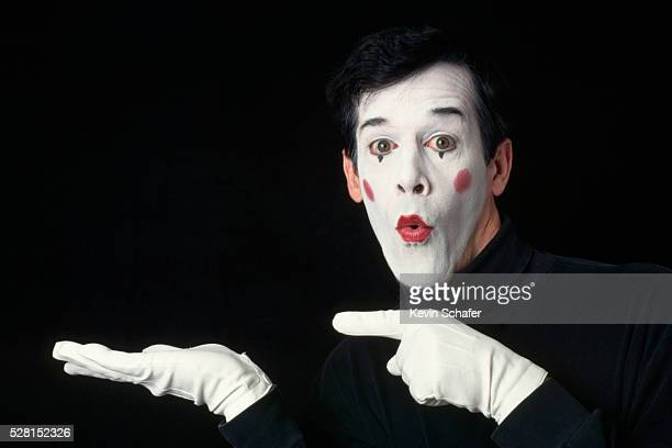 Mime Points Fingers