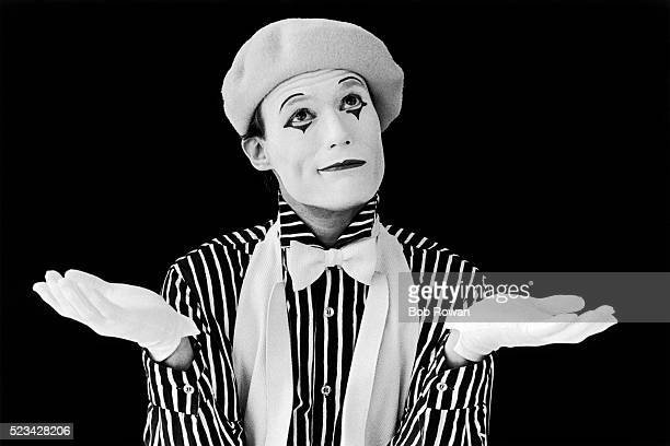 mime shrugging - mime stock photos and pictures