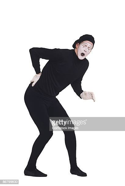 Mime with back pain