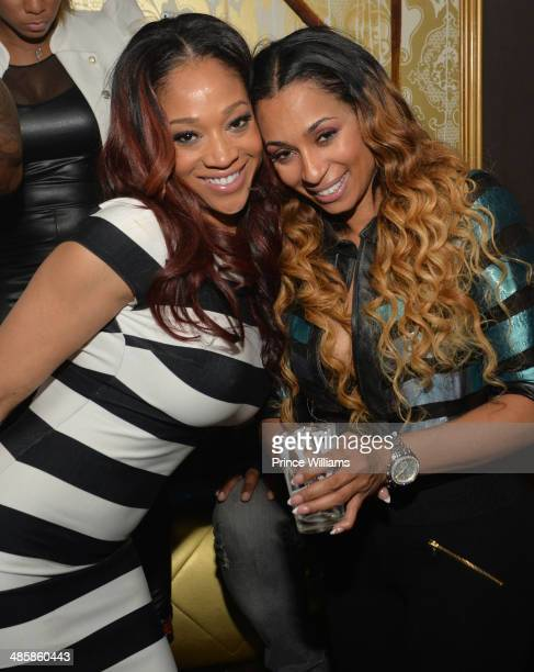 Mimi Faust and Karlie Redd attend a party at Aurum Lounge on April 16 2014 in Atlanta Georgia