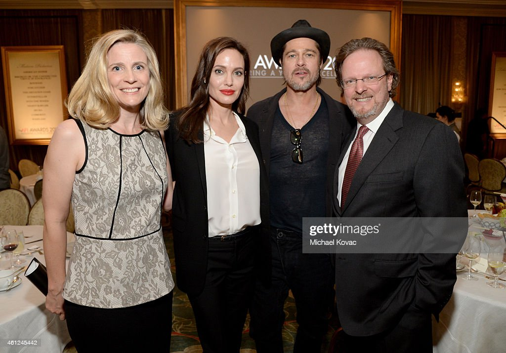 Mimi Gazzale, actors Angelina Jolie and Brad Pitt, and president and CEO of AFI Bob Gazzale attend the 15th Annual AFI Awards Luncheon at Four Seasons Hotel Los Angeles at Beverly Hills on January 9, 2015 in Beverly Hills, California.