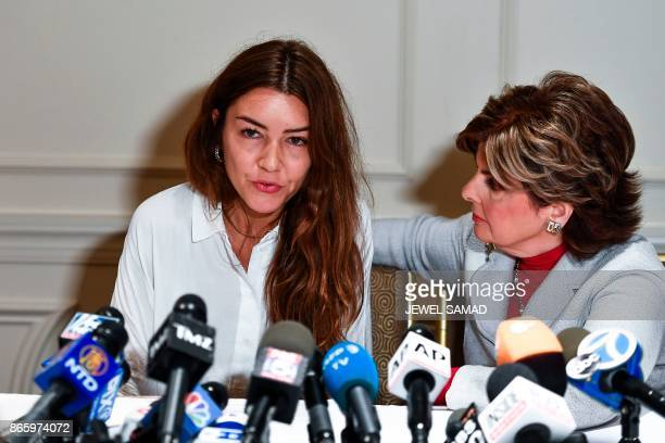 Mimi Haleyi a former production assistant flanked by her lawyer Gloria Allred speaks during a press conference in New York on October 24 2017 during...