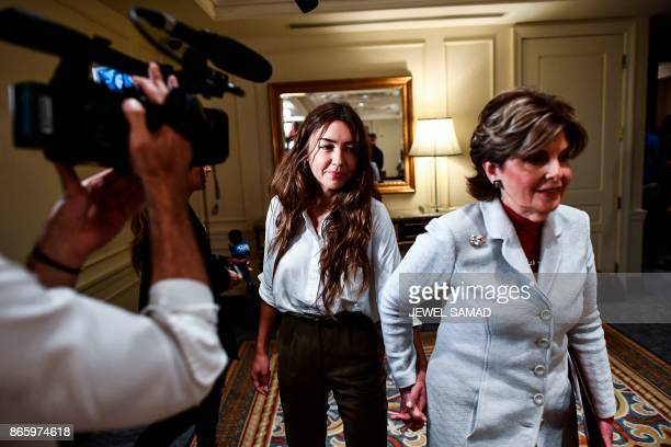 Mimi Haleyi a former production assistant flanked by her lawyer Gloria Allred leaves after speaking at a press conference in New York on October 24...