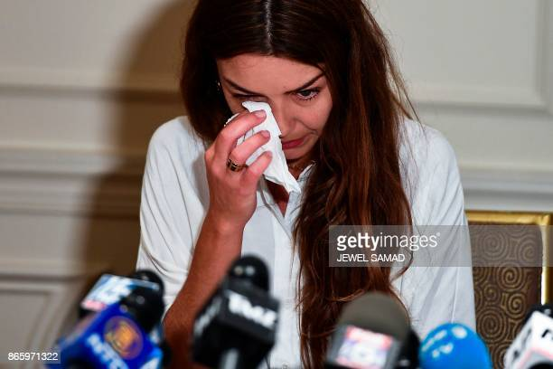Mimi Haleyi a former production assistant wipes tears as she alleges being sexually assaulted by movie mogul Harvey Weinstein during a press...