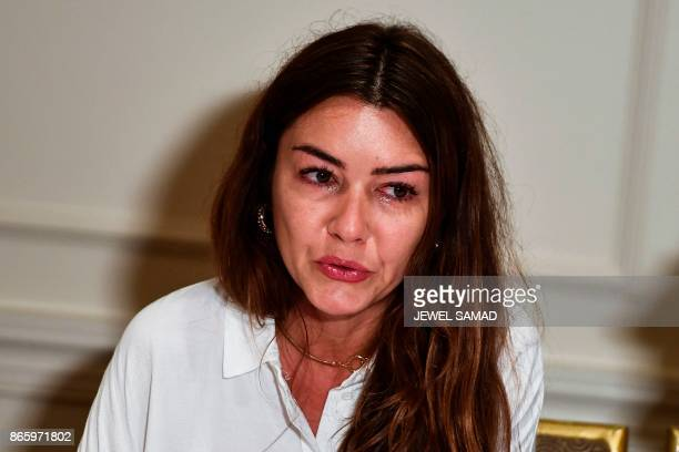 Mimi Haleyi a former production assistant wipes tears during a press conference in New York on October 24 2017 as she alleges to have been sexually...
