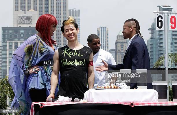 Mimi Imfurst Takeru Kobayashi Tyrone Jackson and Brian Adams attend Nathans Famous Hot Dog Eating Contest via satellite at 230 Fifth Avenue on July 4...