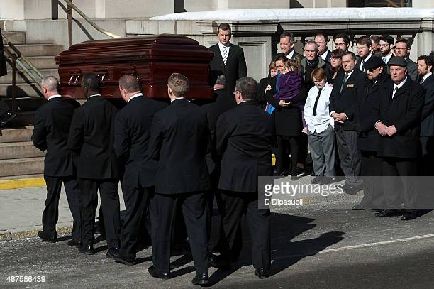 Mimi O'Donnell family members and guests look on as Philip Seymour Hoffman's casket arrives at the funeral service for actor Philip Seymour Hoffman...